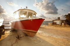 The boat in the parking lot Royalty Free Stock Photo