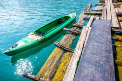 Boat is parking at port on transparent lake Royalty Free Stock Images