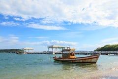 Boat parking in the sea with bridge far Stock Photo