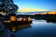 A boat parks in the river in the Old Summer Palace Royalty Free Stock Photos