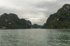 Boat in Passageway. Boat in Narrow Passageway on a Cloudy Day in Ha Long Bay, Viet Nam Stock Photos