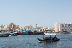 Boat with passangers crossing Dubai Creek river Stock Images