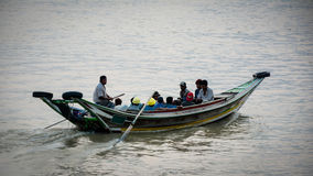 Boat passengers in Hlaing river Royalty Free Stock Photography