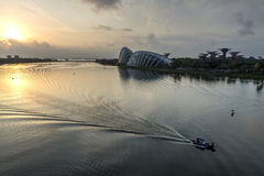 A boat passes by the Flower Dome at Garden By The Bay in early morning. Stock Photography