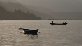 Boat passes from left to right. The silhouette of the boat floats from left to right at sunset stock footage