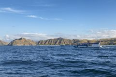Boat passing Padar Island royalty free stock images
