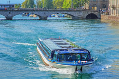 Boat passing along the Limmat river Royalty Free Stock Photo
