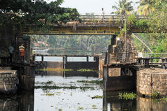 Boat passing a barrage on the way from Kollam to Alleppey Royalty Free Stock Photography