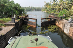 Boat passing a barrage on the way from Kollam to Alleppey Stock Image