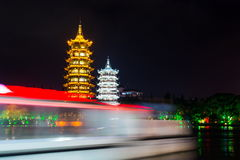 Boat passing buy Guilin twin towers in Guangxi, China Royalty Free Stock Photography