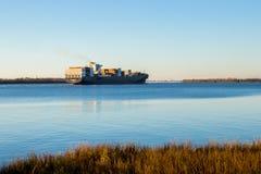 Cargo ship passing through Charleston Harbor stock photos