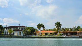 Boat passing by a house on the water stock footage