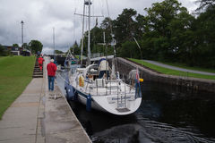 Yacht passing through Neptunes Staircase, Fort William, Scotland Stock Photos
