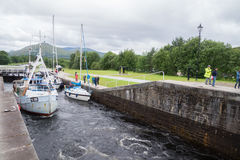 Boats passing through Neptunes Staircase, Fort William, Scotland Royalty Free Stock Image