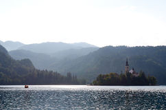 Boat passing over the lake Bled, Slovenia Stock Photos