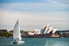 Boat passing by the Sydney Opera House Royalty Free Stock Photography