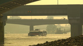 Boat passing under the railway bridge, London. Busy morning shot on and under the Southwark Bridge, London. Boat passing under the bridge, traffic on the bridge stock footage