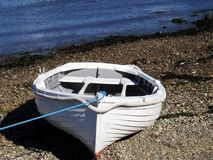 Boat on pebble beach royalty free stock image