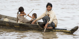 Boat people. Editorial Cambodia Siem reap 2012 June. Vietnamese boat traveling via Mekong river to thonle sap lake For survival royalty free stock photo