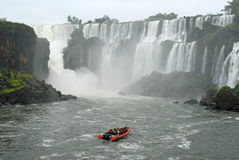 Boat with people in Iguazu waterfalls - Argentina royalty free stock images