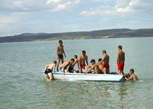 Boat with people on the lake. Young people go boating on the mountain lake Chaghytay in the center of Siberia in Tuva Stock Photos