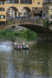 The boat with people near the bridge on the river Stock Photography