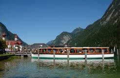 Boat and people at pier at St. Bartholoma church. Stock Photo