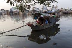 Boat people on Saigon river Royalty Free Stock Image