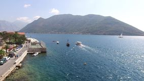 Boat in Perast. Boat dock on the waterfront of the city of Peras. T, near the old town. Montenegro stock video footage