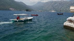 Boat in Perast. Boat dock on the waterfront of the city of Peras. T, near the old town. Montenegro stock footage