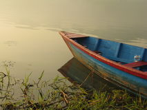 Boat by the Phewa shore Royalty Free Stock Image