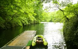 Boat and pier. A green smal boat near pier Stock Photography