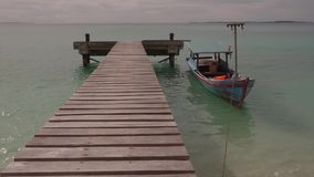 Boat at pier on calm sea tropical island. On Sumatra with small waves stock footage