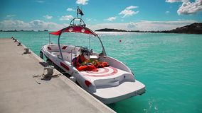 Boat at the pier of Caribbean island of San Martin waiting for tourists stock video