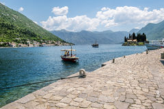 The boat pier on Church Island Gospa od Shkrpela in Kotor bay. Stock Photos