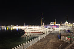 Boat and pier on Geneva lake by night Royalty Free Stock Image