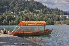 Boat at the pier of Lake Bled island. Royalty Free Stock Image