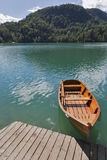 Boat at the pier of Lake Bled. Royalty Free Stock Photo