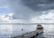 Boat at the pier next to lake Stock Photography