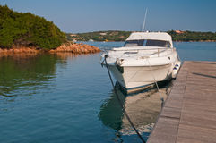 Boat at a pier on Sardinia Island Royalty Free Stock Photos