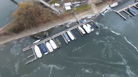 Boat pier and ships in the harbor - ice floes stock video footage