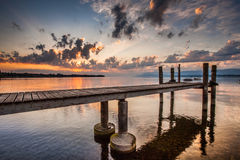Boat Pier and Sunrise Stock Photography
