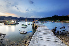 Boat pier at sunset Royalty Free Stock Photo