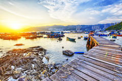 Boat pier at sunset Stock Image