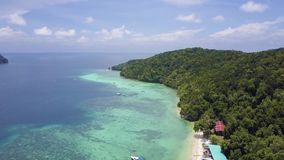 Pier of Manukan Island. Boat at the pier and view straight to the coastline stock video