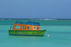 Boat, Pigeon Point Beach, Tobago. Boat in Caribbean sea, Tobago, Caribbean Stock Photos