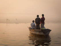 Boat with Pilgrims Approaching the East Bank of the Ganges River Stock Photography