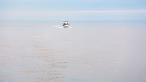 Boat with pilot in Baltic sea in morning mist Royalty Free Stock Images