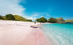 A Boat on Pink Beach. With Turquoise Clear Water in Komodo Island, Indonesia royalty free stock photos
