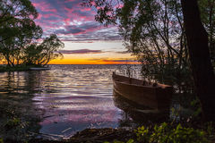 The boat on a pink decline Stock Photography